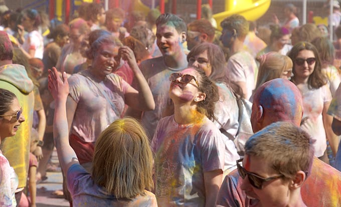 crowd covered in colored powders